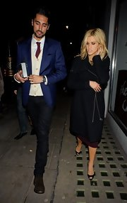 Ashley Roberts sported a long wool coat while out late in London.