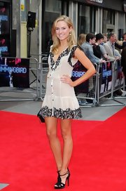 Kimberley Garner wore a nude-colored dress with black lace embroidery at the hem, neck, and sleeve for her look at the 'Hummingbird' premiere in London.