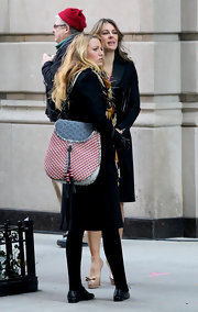 Blake Lively punched up her black coat on the set of 'Gossip Girl' with an eclectic Lara bag, which exposed her Marc by Marc Jacobs laptop case.