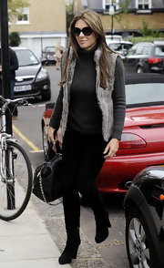 Elizabeth Hurley showed off her chic street style in a gray turtleneck paired with black knee-high boots.