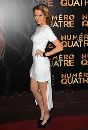 Terea Palmer added contrast to her white dress with black suede pumps.