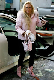 Everything about Coco's ensemble--the jacket, the boots, and the studded pink tote--was just too cute!
