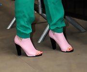 Iggy Azalea chose a pair of light pink ankle booties with a peep toe for her look at the BBC Radio Studios.