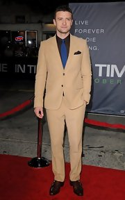 Justin Timberlake took a different approach to red carpet style at the 'In Time' premiere in a camel suit and a royal blue tie.