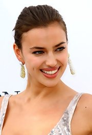 Irina adorned her hears with these beaded cluster dangle earrings.