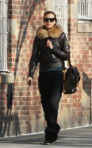 Irina looked aviator-chic in this chocolate brown leather jacket with a fur collar.