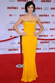 Jamie Alexander highlighted her killer collarbones and her enviable figure in a canary yellow evening dress.