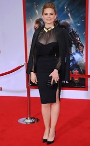 Hayley Atwell chose this black LBD with sheer sleeves and neck for her super sleek red carpet look.