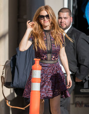 Isla Fisher went flirty in a Self-Portrait lace mini dress with a peekaboo front while visiting 'Kimmel.'