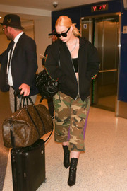 Iggy Azalea completed her airport ensemble with a quilted black backpack by Chanel.