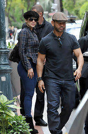 J-Lo stepped out with her hair tucked into a chic suede newsboy cap.