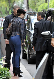 Jennifer showed off her famous derriere in a pair of skin-tight skinny jeans and black suede stiletto ankle boots.