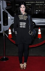 Kat Von D added some flair to her all black look with her military jacket with gilded embellishments.