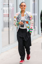 Jada Pinkett Smith added an extra pop of color with a pair of red Adidas Gazelles.