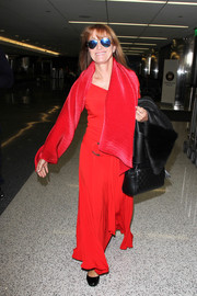 Jane Seymour was spotted at LAX wearing a red maxi dress with a matching scarf.