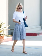 January Jones styled her simple top with a striped skirt.