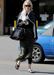 January Jones hit the nail salon carrying a purple leather Hillary Satchel with gold trim.