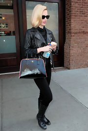 January Jones headed out on a press junket wearing a pair of black leather boots featuring metal embellishments.