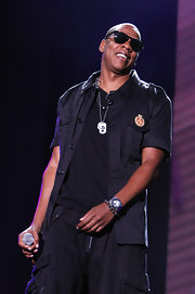 Jay-Z wears a short sleeve button-up for his on stage attire.
