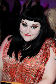 Beth Ditto swept on a rich metallic copper shadow and vibrant jade green liner for the Jean Paul Gaultier fashion show in Paris.