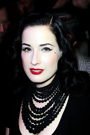 Dita Von Teese paired a lot of black liquid liner with shiny red lips at the Jean Paul Gaultier fashion show in Paris.