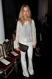 Rachel Zoe donned a stylish white ensemble at the Jean Paul Gaultier show in Paris. She accessorized the look with a dark brown leather clutch with gold hardware detailing.