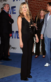 Jenifer Aniston was chic in all black at the Lifetime premiere of 'Five.' She donned a black vest paired with black pants and perfectly styled blond locks.