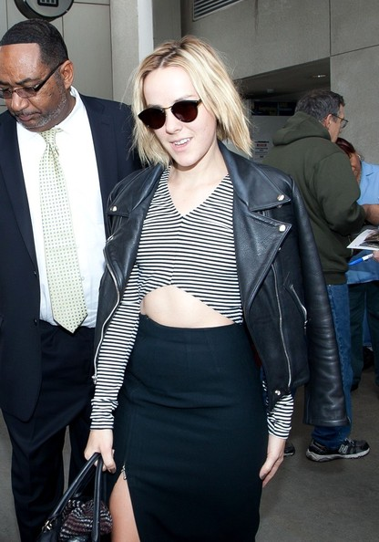 Jena Malone layered a striped crop-top under a leather jacket for a flight.