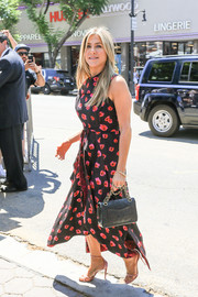 Jennifer Aniston was summer-chic in a sleeveless floral dress by Proenza Schouler during Jason Bateman's Hollywood Walk of Fame ceremony.