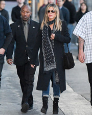 Jennifer Aniston arrived for her 'Kimmel' appearance all bundled up in a black Celine coat and a patterned scarf.