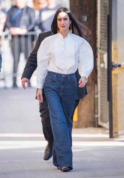 Jennifer Connelly teamed her top with a pair of blue flare jeans.