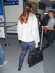 Jennifer Garner took a flight out of LAX carrying a black leather tote by Chanel.