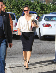 Jennifer Garner paired her blouse with a simple black pencil skirt.