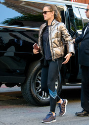 Jennifer Garner sealed off her look with a pair of APL running shoes.