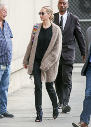 Jennifer Lawrence teamed her cardigan with black trousers and a matching tee.