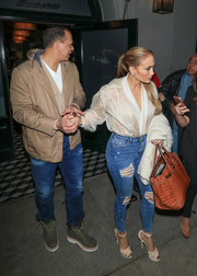 Jennifer Lopez turned heads in a sheer white Ashish blouse and torn skinny jeans while leaving Craig's Restaurant.