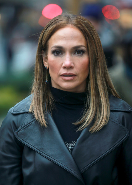 Jennifer Lopez wore a simple, classic center-parted hairstyle on the set of 'Second Act.'