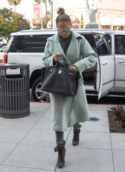 Jennifer Lopez styled her look with a pair of gray suede ankle boots by Giuseppe Zanotti.