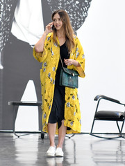 Jessica Alba was spotted out in LA carrying a green chain-strap bag by Bulgari, which contrasted nicely with her yellow coat.