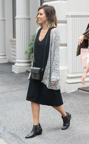Jessica Alba brightened up her LBD with a gray Stylestalker cardigan.