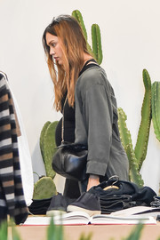 Jessica Alba stepped out for a day of shopping carrying a chic black leather bag with a gold chain strap.