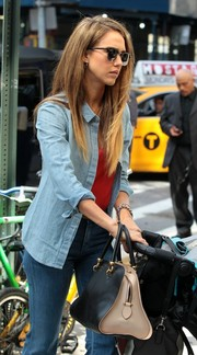 Jessica Alba did a coffee run in NYC carrying a stylish black and beige leather tote by Tod's.