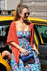 Jessica Alba went all out with the colors during a trip to Manhattan, teaming a cobalt satchel with an orange cardigan and a vibrant print dress.
