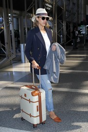 Jessica Alba completed her travel outfit with pointy tan d'Orsay flats by Jenni Kayne.