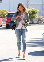 Jessica Alba headed to work looking edgy in Citizens of Humanity distressed jeans and a moto-chic gray cardigan.