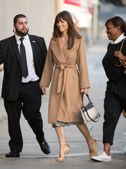 Jessica Biel headed to 'Kimmel' looking ultra stylish in a belted camel-hair coat by Max Mara.