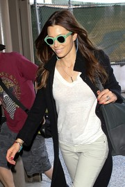 Jessica Biel caught a flight at LAX looking cool in her round green sunnies.