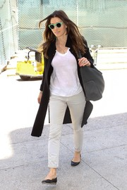 Jessica Biel kept her travel outfit comfy with black ballet flats.