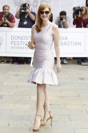 Jessica Chastain paired her lovely frock with nude slim-strap sandals, also by Michael Kors.
