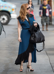 Jessica Chastain cut a stylish figure in a blue Givenchy dress with a button-up bodice and a black ruffle hem while headed to 'Kimmel.'